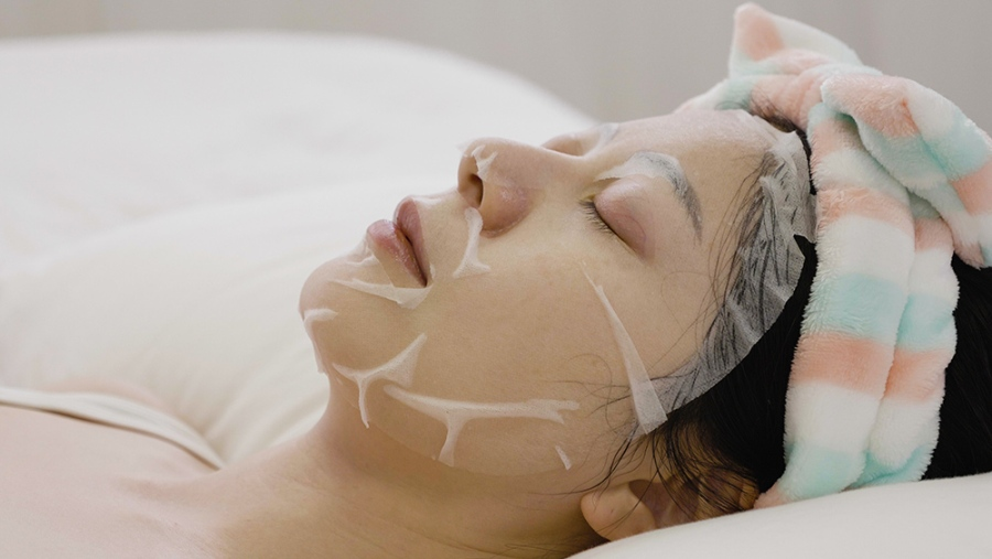 Korean Sheet Mask in Use Lying Down
