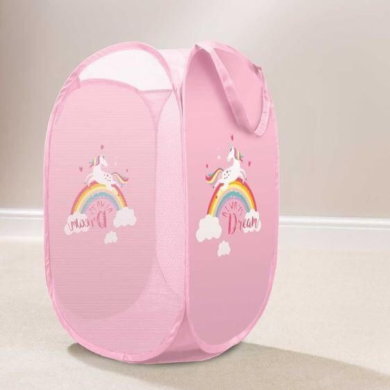 Tidy your little one dirty clothes in style with this pink unicorn pop up laundry basket.
