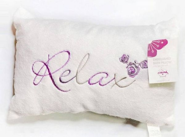 Luxury white bath pillow with relax embroidery designed for you to achieve ultimate relaxation in the bath.