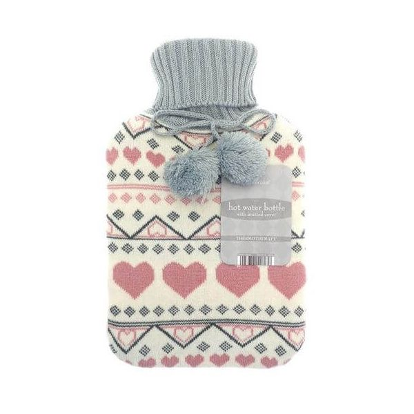 Get instant comfortable heat with this cream knitted hot water bottle. Comes in a trendy jacquard hearts design.